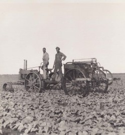 Spraying-the-fields-on-the-tractor-1930s-e1431493216976
